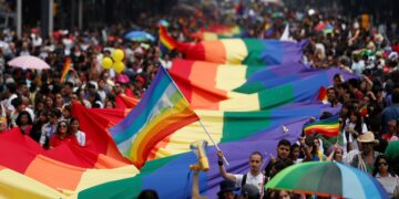 Participants hold up rainbow flags during an annual Gay Pride Parade in Mexico City, Mexico June 25, 2016. REUTERS/Edgard Garrido