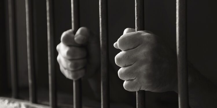Hands holding the bars